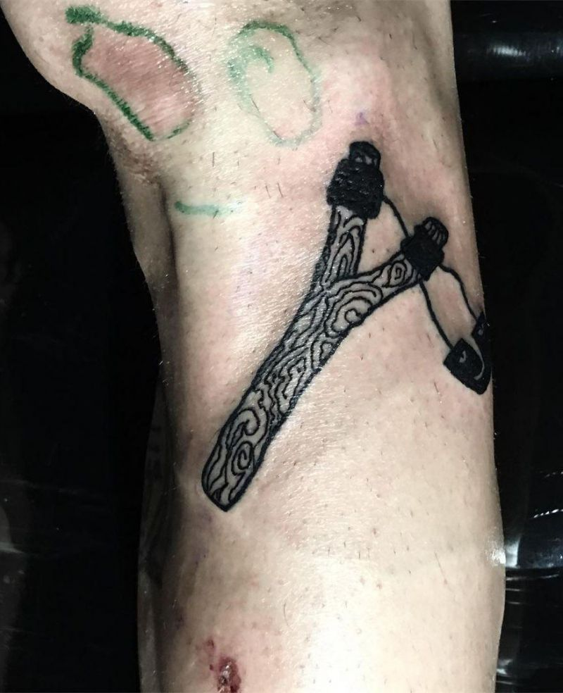 30 Perfect Slingshot Tattoos You Can Copy